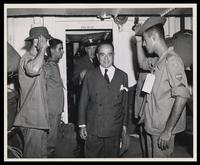 Brazilian president Getulio Vargas, Coast Guard Captain George W. McKean and Brazilian soldiers in troop quarters aboard Coast Guard-manned troop transport