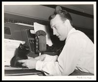 "Felix Grant holds ""Muscles"" the cat, WWDC-AM 1450, Washington, D.C., 1951"